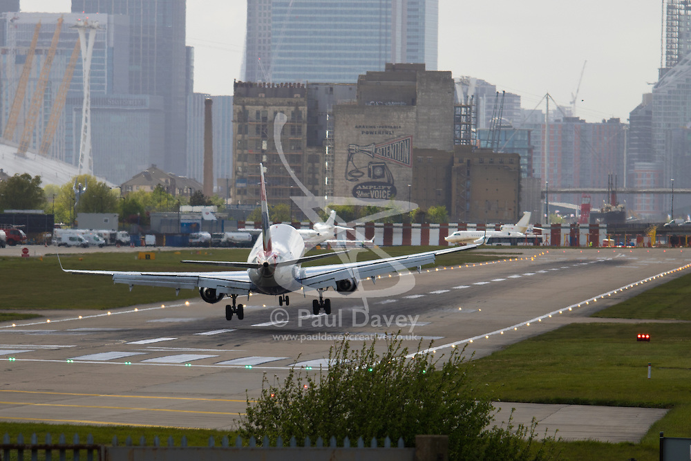 "London City Airport, May 5th 2015. With crosswinds gusting at up to 45 mph, several planes attempting to land at London City Airport have to abort their landings and do a ""go-round"" whilst others endured rough landings.  PICTURED: Wings rocking, a plane crabs sideways into the runway."