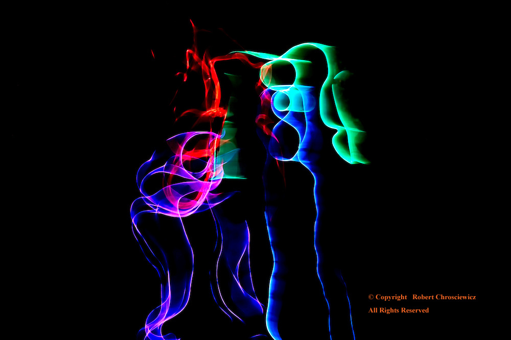 Night Dance: Two dancers clad in LED lit body suites perform during an evening's event and are captured with a long exposure as if they were capricious ghosts, Vancouver British Columbia Canada.