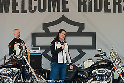 Harley-Davidson's Jen Gersch describes the attributes of the just introduced HD 1200T Sportster with Chris Feck at the Harley-Davidson Display during Daytona Bike Week. , FL., USA. March 8, 2014.  Photography ©2014 Michael Lichter.