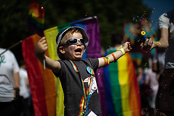 © Licensed to London News Pictures . 24/08/2019. Manchester, UK. SAMUEL WALKLATE (four) . The 2019 Manchester Gay Pride parade through the city centre , with a Space and Science Fiction theme . Manchester's Gay Pride festival , which is the largest of its type in Europe , celebrates LGBTQ+ life . Photo credit: Joel Goodman/LNP