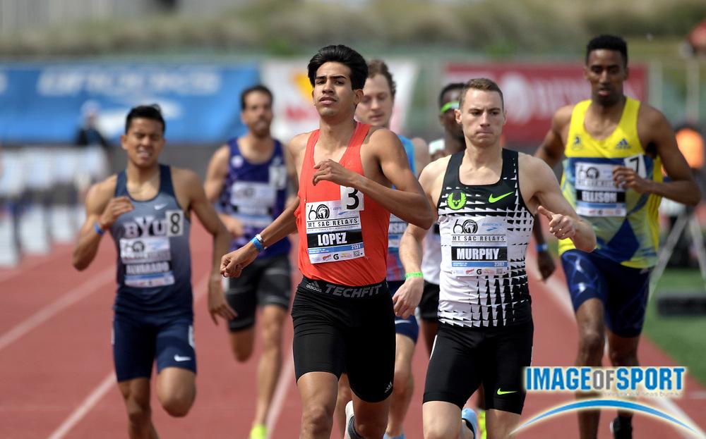 Apr 21, 2018; Torrance, CA, USA; Jesus Tonatiu Lopez (MEX) defeats Clayton Murphy to win the invitational 800m, 1:47.07 to 1:47.22,  during the 60th Mt. San Antonio College Relays at Murdock Stadium.