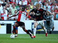 Photo: Maarten Straetemans.<br /> Feyenoord v Liverpool. Rotterdam Tournament. 05/08/2007.<br /> Andwelé Slory (left) with John Arne Riise from Liverpool