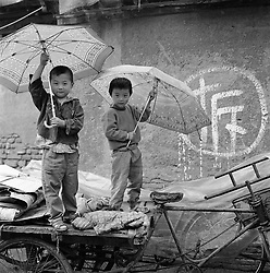 Children waiting to move out of house soon to be demolished in Beijing China