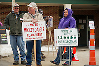 Mickey Daigle (far left) stand among the sign holders outside of Gilmanton Elementary School during polling hours onTuesday afternoon.  (Karen Bobotas/for the Laconia Daily Sun)