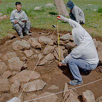 A Smithsonian Museum archaeology team studies a 2700+ year-old khirigsur burial mound at Ulaan Tolgoi site near Lake Erkhel & Muren, Mongolia.