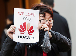 A woman holds up a sign in support of Huawei at a B.C. courthouse prior to the bail hearing for Meng Wanzhou, Huawei's chief financial officer on Monday, December 10, 2018 in Vancouver, BC, Canada. Photo by Jonathan Hayward/CP/ABACAPRESS.COM
