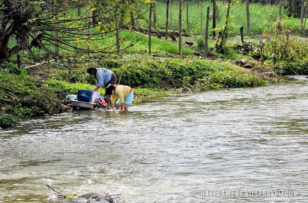 Two women do their laundry early in the morning in the river in Sam Neua (also spelled Samneua, Xamneua and Xam Neua) in northeastern Laos.