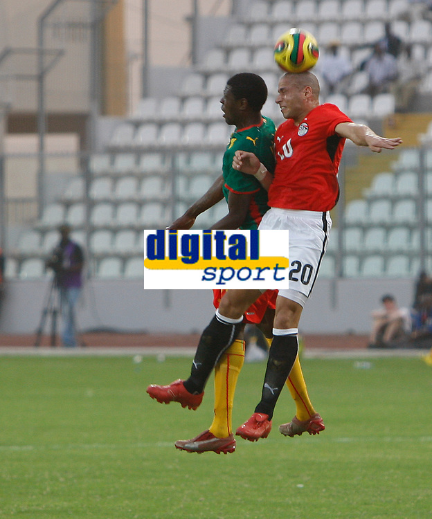 Photo: Steve Bond/Richard Lane Photography.<br />Egypt v Cameroun. Africa Cup of Nations. 22/01/2008. Wael Gomaa (R) beats Mohamadou Idrissou (L) in the air