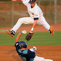 Seahawks David Shambley (40) slides under the tag of Old Dominion's Joshua Wright (6) on day one of the CAA baseball championship at Brooks Field Thursday, May 26, 2011. Photo By Mike Spencer/STAR-NEWS