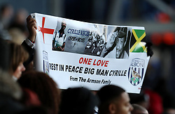Fans hold up a banner during the memorial service for Cyrille Regis at The Hawthorns, West Bromwich.