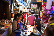 One of the popular markets in Bangkok, Sampeng is an endless sprawl of stalls selling random toys and trinkets, latest inventions, jewelry, fabric. The market is jam packed with shoppers and street food carts and trolleys. Thailand.