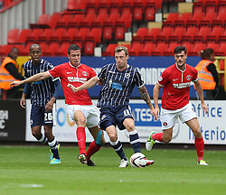Millwall's Martyn Woolford is challenged by Charlton Athletic's Dorian Dervite - Photo mandatory by-line: Robin White/JMP - Tel: Mobile: 07966 386802 21/09/2013 - SPORT - FOOTBALL - The Valley - Charlton - Charlton Athletic V Millwall - Sky Bet Championship