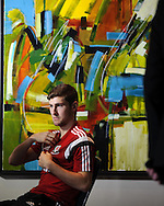 Ben Davies of Wales talks to the media during the Wales football player media session at the St.Davids Hotel in Cardiff Bay , South Wales on Thursday 14th November 2013. pic by Andrew Orchard, Andrew Orchard sports photography,