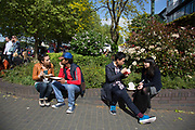 Friends eating lunch during a food festival. The South Bank is a significant arts and entertainment district, and home to an endless list of activities for Londoners, visitors and tourists alike.