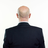 studio portrait isolated on white background of a man senior back rear view on white background