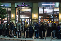 © Licensed to London News Pictures. 12/09/2020. Manchester, UK. Drinkers crowd outside the Paramount Wetherspoons in Manchester tonight [12/09/2020]. New restrictions are introduced on Monday [14/09/2020] which will limit gatherings to 6 people. Photo credit: Kerry Elsworth/LNP