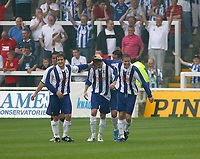 Photo: Andrew Unwin.<br />Hartlepool United v Leeds United. Pre Season Friendly. 22/07/2006.<br />Hartlepool's James Brown (C) is congratulated by his team mates after scoring his second goal.