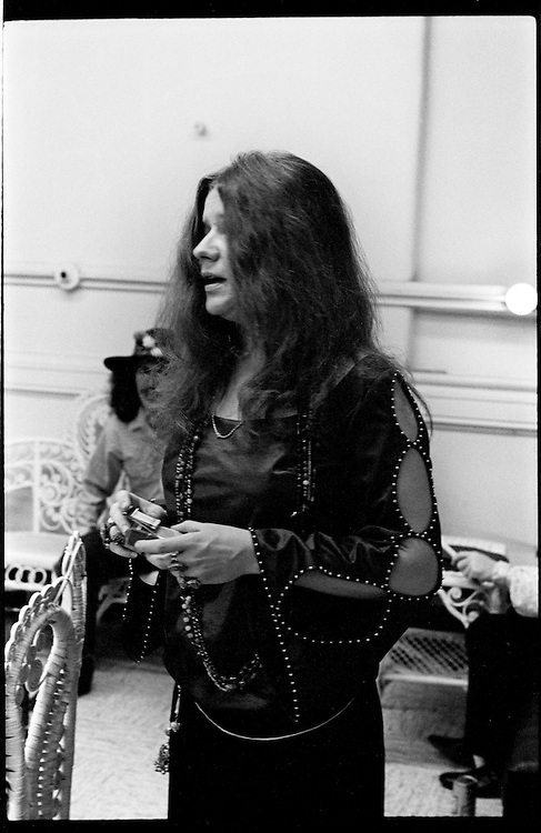 """1960's American singer - songwriter Janis Joplin relaxes backstage at Cincinnati Music Hall before taking the stage in 1968. Janis died of a heroin overdose in 1970.<br /> Janis Lyn Joplin; January 19, 1943 – October 4, 1970 was an American singer-songwriter who first rose to fame in the late 1960s as the lead singer of the psychedelic-acid rock band Big Brother and the Holding Company, and later as a solo artist with her own backing groups, The Kozmic Blues Band and The Full Tilt Boogie Band. Her first ever large scale public performance was at the Monterey Pop Festival; this led her to becoming very popular and one of the major attractions at the Woodstock festival and the Festival Express train tour. Joplin charted five singles; other popular songs include: """"Down on Me""""; """"Summertime""""; """"Piece of My Heart""""; """"Ball 'n' Chain""""; """"Maybe""""; """"To Love Somebody""""; """"Kozmic Blues""""; """"Work Me, Lord""""; """"Cry Baby""""; """"Mercedes Benz""""; and her only number one hit, """"Me and Bobby McGee"""".  She was inducted into the Rock and Roll Hall of Fame in 1995."""