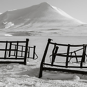 2 Iron Bed frames in an otherwise wide open snow field, Adventdalen