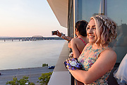 Madison Combs looks west from the sixth floor balcony as Fairdale High School holds it's prom at the Muhammad Ali Center on Saturday, May 18.
