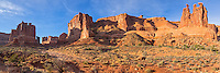 """The courthouse towers are a large rock formation in the middle of Arches National Park. The three spires on the right are known as the """"Three Gossips"""". The early morning light gave the scene more depth and even brighter colors."""