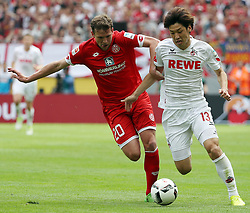 COLOGNE, May 21, 2017  Yuya Osako (R) of 1. FC Koeln and Fabian Frei of FSV Mainz 05 vie for the ball during the Bundesliga match in Cologne, Germany, May 20, 2017. Koeln won 2-0. (Credit Image: © Ulrich Hufnagel/Xinhua via ZUMA Wire)