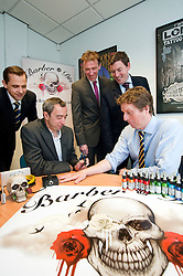 Managaing Director of Barber (DTS) Of Sheffield Ltd Tony Crane (second left) explains the uses of some of the Tattooing equipment supplied by his company   to Investors (from left to right)  Andy Dodd and James Dow of PHD and Paul Betts and Wayne Thomas of EV group..16  May 2012.Image © Paul David Drabble