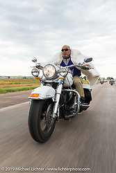 """Rich Robbins aka """"Buddha"""" on the annual Michael Lichter - Sugar Bear Ride hosted by Jay Allen from the Easyriders Saloon during the Sturgis Black Hills Motorcycle Rally. SD, USA. Sunday, August 3, 2014.  Photography ©2014 Michael Lichter."""