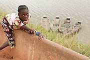 Young girl sitting on a wall in the town of Faye, Bas-Sassandra region, Cote d'Ivoire on Monday March 5, 2012.