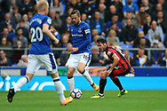 Gylfi Sigurdsson of Everton (c) passes the ball under pressure from Adam Smith of Bournemouth. Premier league match, Everton vs Bournemouth at Goodison Park in Liverpool, Merseyside on Saturday 23rd September 2017.<br /> pic by Chris Stading, Andrew Orchard sports photography.