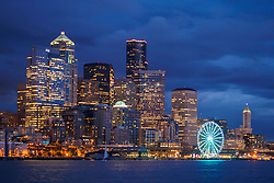 North America, United States, Washington, Seattle. The downtown skyline at dusk, seen from Elliott Bay looking east.