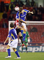Photo: Paul Greenwood.<br />Sheffield United v Cardiff City. Coca Cola Championship. 02/10/2007.<br />Cardiff's Glen Loovens (R) outjumps James Beattie in the air