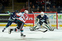 KELOWNA, CANADA - JANUARY 30: Kyle Crosbie #25 of the Kelowna Rockets takes a second period shot and scores a goal on Roddy Ross #1 of the Seattle Thunderbirds on January 30, 2019 at Prospera Place in Kelowna, British Columbia, Canada.  (Photo by Marissa Baecker/Shoot the Breeze)