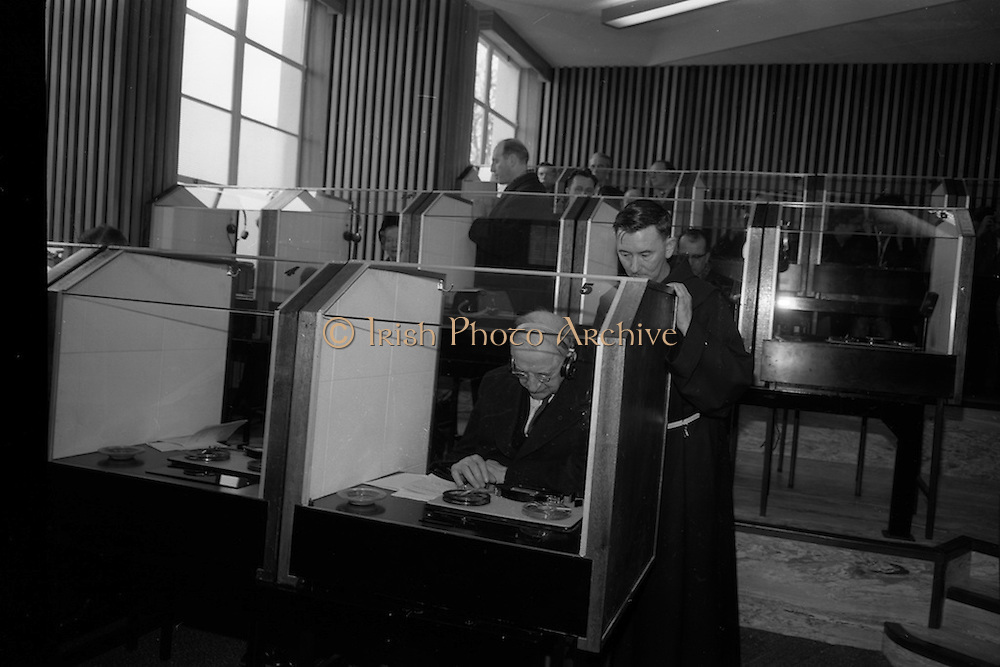 8/3/1965<br /> 3/8/1965<br /> 8 March 1965<br /> <br /> Éamon de Valera being shown the booths by An tath. Colman O huallachain O.F.M Director of AnTeanglann