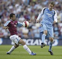 Photo: Aidan Ellis.<br /> Manchester City v West Ham United. The Barclays Premiership. 23/09/2006.<br /> City's Dietmar Hamann nips the ball past West Ham's Javier Mascherno