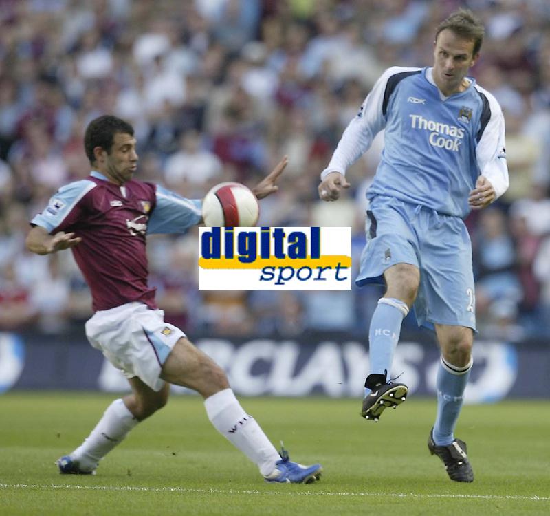 Photo: Aidan Ellis.<br /> Manchester City v West Ham United. The Barclays Premiership. 23/09/2006.<br /> City's Dietmar Hamann nips the ball past West Ham's Javier Mascherno