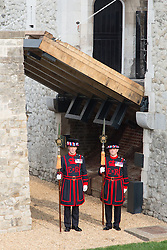 © Licensed to London News Pictures. 02/04/2014. London, UK. Yeomen Warder stand underneath a new drawbridge which is opened at the Tower of London in Tower Hill, London today, 2nd April 2014. This is the first working and rising drawbridge at the Tower of London since the 1970's. Photo credit : Vickie Flores/LNP