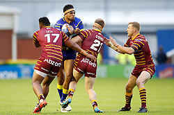 Warrington Wolves' Sitaleki Akauola is tackled by Huddersfield Giants Ukuma Ta'aii (left) and Adam O'Brien (centre) and Ryan Hinchcliffe (right) during the Betfred Super League match at the Halliwell Jones Stadium, Warrington.