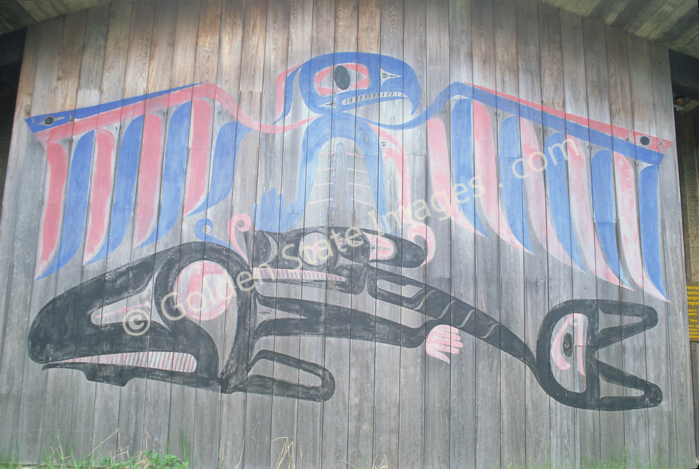 Native Indian art painted on the side of a longhouse. This painting includes an Orca (Killer Whale).
