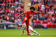 Leyton Orient defender Joe Widdowson (3) beats AFC Flyde midfielder Nick Haughton (27) to the ball during the FA Trophy final match between AFC Flyde and Leyton Orient at Wembley Stadium on 19 May 2019.