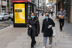 © Licensed to London News Pictures. 15/10/2020. LONDON, UK.  An illuminated sign at a bus stop in Westminster indicates England alert level : Tier 1, Medium (the rule of six applies indoors and outdoors, pubs and restaurants shut at 10pm).  To try to further control the coronavirus pandemic, the UK government has announced today that from Saturday the capital, as well as other regions in the UK, will move to the more stringent England alert level :Tier 2, High (no households mixing indoors, the rule of six applies outdoors, pubs and restaurants shut at 10pm).  Photo credit: Stephen Chung/LNP