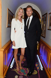 SEB BISHOP and his wife HEIDI  at the launch of Bluehouse, Samsung's Exclusive New members Club held at Annabel's, 44 Berkeley Square, London on 1st July 2013.