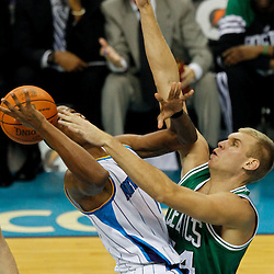 December 28, 2011; New Orleans, LA, USA; New Orleans Hornets small forward Trevor Ariza (1) has the ball knocked away by Boston Celtics center Greg Stiemsma (54) during the third quarter of a game at the New Orleans Arena. The Hornets defeated the Celtics 97-78.  Mandatory Credit: Derick E. Hingle-US PRESSWIRE