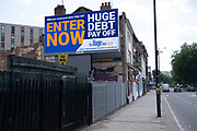Large scale sign for The Huge Debt Payoff company on 19th July 2021 in Birmingham, United Kingdom. Lots of advertising for this have appeared over the city as people struggle with their unsecured debts, especially during and following the coronavirus pandemic. Those who enter have a chance to have their unsecured debts cleared with The Huge Debt Pay off from Open Mind Group.