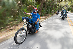 Roy Kawahara riding through Tomoka State Park during Daytona Bike Week 75th Anniversary event. FL, USA. Thursday March 3, 2016.  Photography ©2016 Michael Lichter.