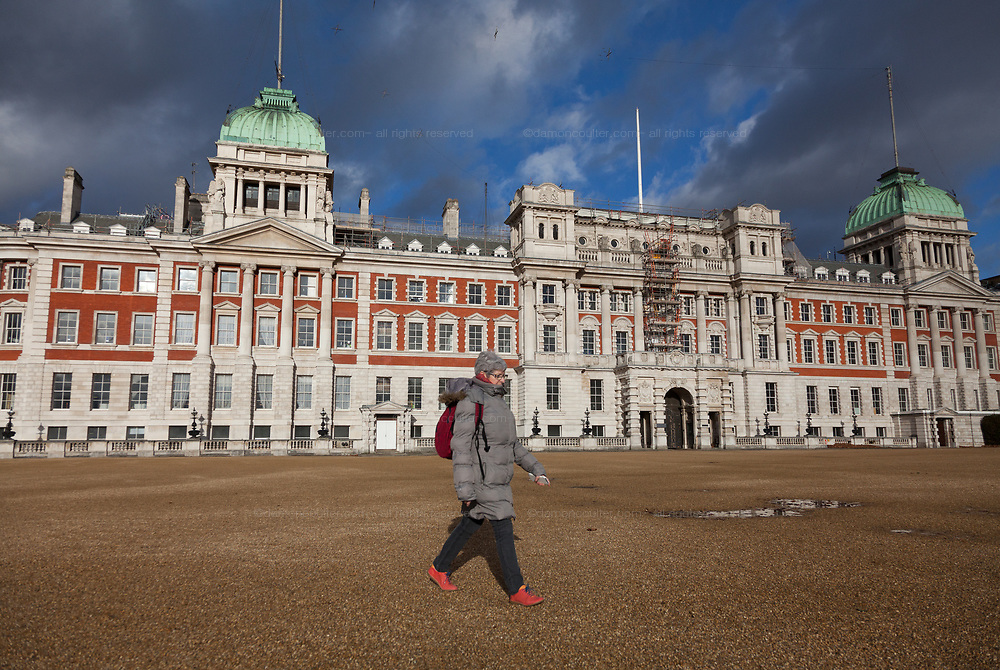 A woman tourist crosses Horse Guards Parade in Whitehall, London Friday January 5th 2018