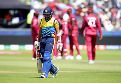 Sri Lanka's Kusal Mendis leaves the pitch after being dismissed by West Indies' Fabian Allen during the ICC Cricket World Cup group stage match at The Riverside Durham, Chester-le-Street.