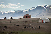 View of the summer camp of Muqur, Er Ali Boi's place. Behind the mountains in the distance is Tajikistan...Trekking through the high altitude plateau of the Little Pamir mountains (average 4200 meters) , where the Afghan Kyrgyz community live all year, on the borders of China, Tajikistan and Pakistan.