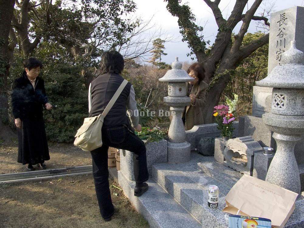 tending to a family memorial grave