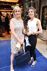 Left to right, COUNTESS ALEXANDER OF TUNIS and her daughter LADY ROSE ALEXANDER at the Ralph Lauren Wimbledon Party held at Ralph Lauren, 1 New Bond Street, London on 17th June 2010.